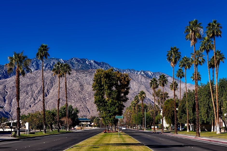palm springs road with mountain background